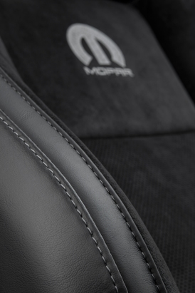 Tungsten stitching matching the embroidered Mopar logo borders the performance seats and continues throughout the Mopar '17, touching the door panels and additional interior areas.